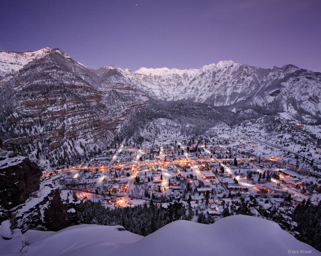 Skies clear at twilight after several days of snow storms in Ouray, Colorado in the San Juan Mountains.